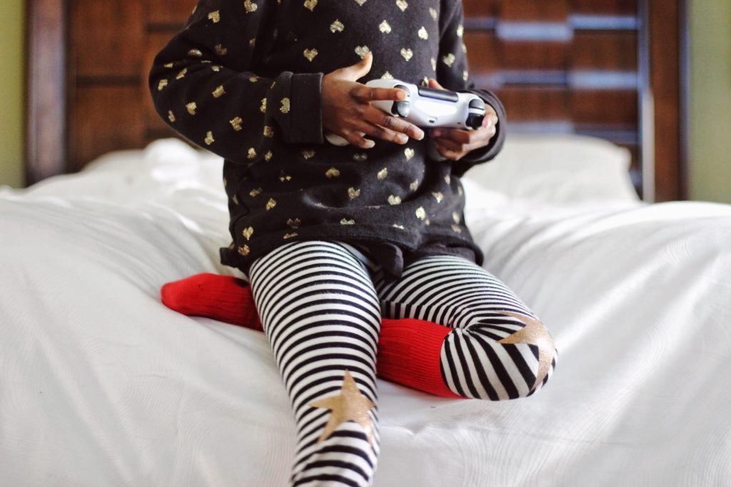 A young child playing a video game.